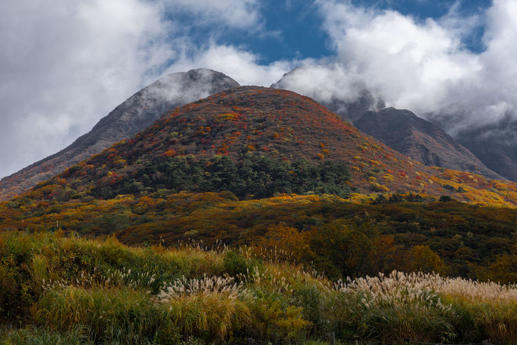 Low angle view of mountain against sky during autumn