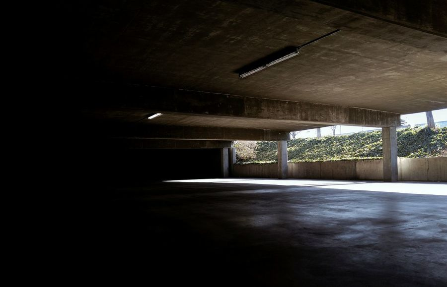 Introverted extrovert Through Throuceiling Indoors  No People Illuminated Built Structure Architecture Space Night Empty Lights And Shadows Darktones Parking Garage Duotones Darkness Darkness And Light Architecture Utahphotographer HighContrastPhotography