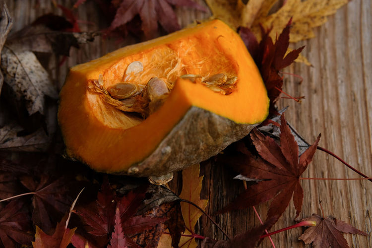 Vegetarian Food Winter Beauty In Nature Close-up Day Freshness Healthy Eating Leaf Nature No People Orange Color Outdoors Pumpkin Vegan Vegetable Wooden Background