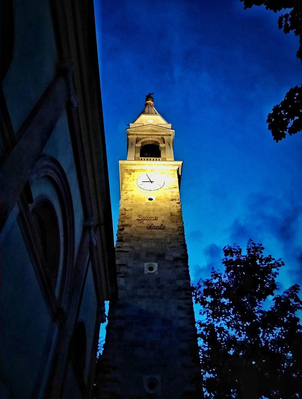 LOW ANGLE VIEW OF CLOCK TOWER AMIDST BUILDING AGAINST SKY