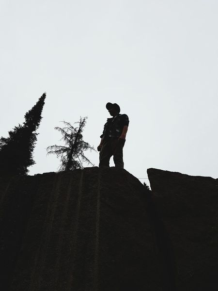 On the rocks Only Men Silhouette Adult People Low Angle View Day RISK Outdoors Headwear Sky Nature Photography Adventure Is Out There Adventurer Nature Contrast In Nature EyeEmNewHere Blackandwhite Photography Contrast Cliff View Artistic Photo Cliffs Edge