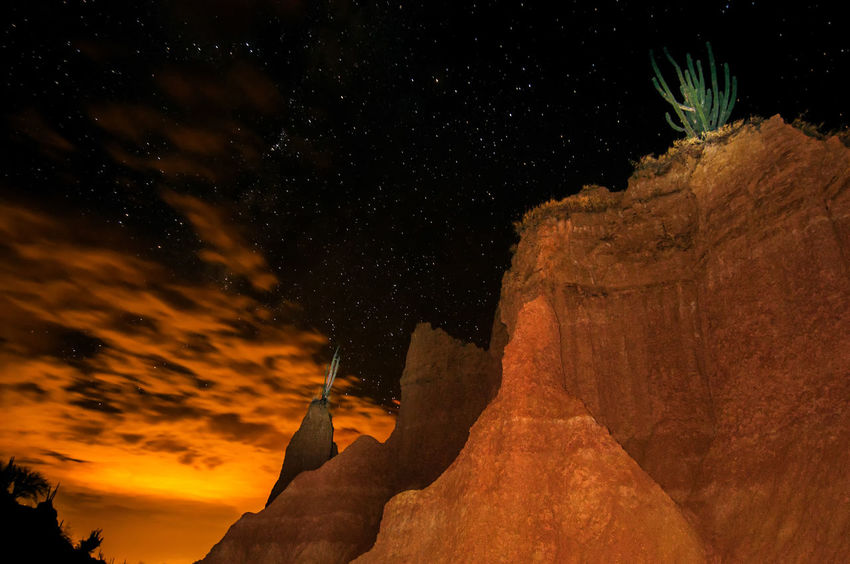 Dramatic view of Tatacoa desert at night in Huila, Colombia Arid Climate Clouds Colombia Desert Desolate Drought Dry Heat Hot Huila  Idyllic Land Landscape Nature Nocturnal Outdoors Sand Scenics Shrub Sky Blue South America Tatacoa Tourism View Wilderness
