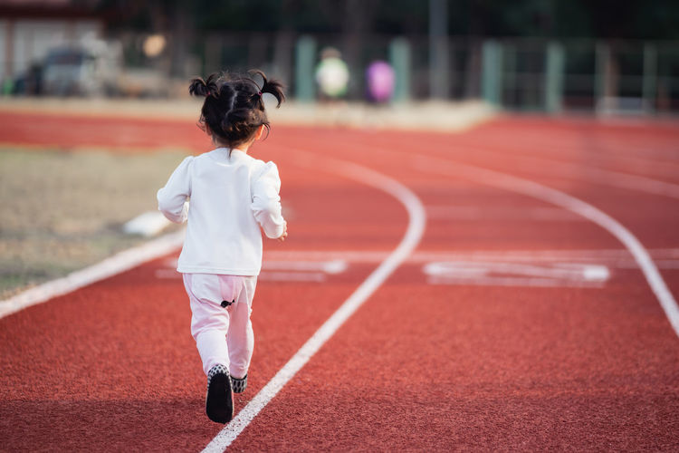 Rear view of boy running