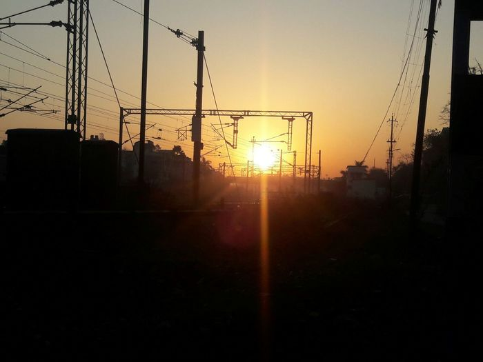 I was going to gym, and while crossing railway line...I captured.. Morning View Morning Light Sunshine Silhouette Sunrising Railway Track Railway Line Yellow Sun Peaceful View Going For Gym Lovely Day Nature Photography Nature