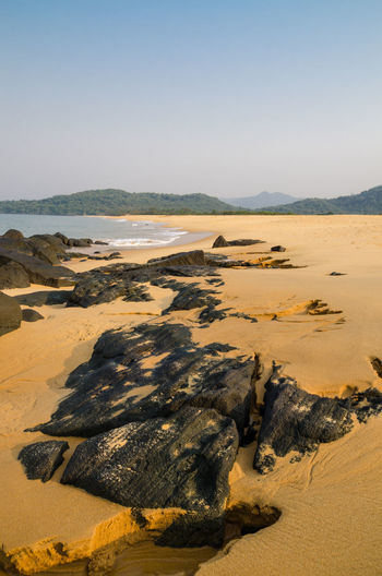 Dark yellow sand at John Obey Beach, Sierra Leone John Obey Beach Rock Sierra Leone Africa Arid Climate Beauty In Nature Clear Sky Day Desert Landscape Nature No People Outdoors Physical Geography Rock - Object Sand Sand Dune Scenics Sky Tranquil Scene Tranquility Travel Destinations