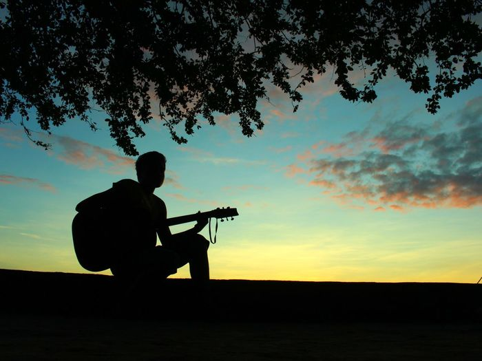 Silhouette of man playing at night