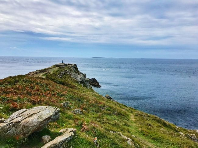 Le Conquet Finistere Brittany Ocean Ocean View Sea Sky Horizon Over Water Nature Scenics Beauty In Nature Tranquility Cloud - Sky Tranquil Scene Water Rock - Object One Person Sitting Sitting Outside One Person Only Loneliness Day Outdoors Grass