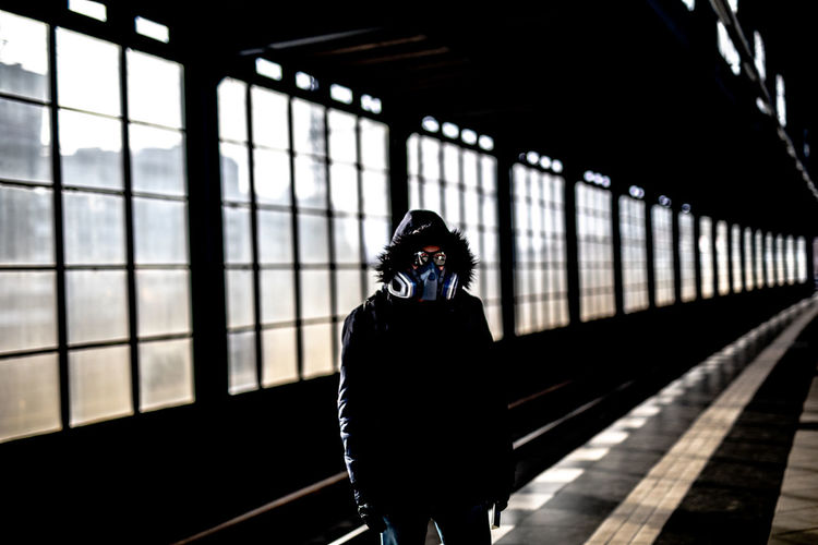 Person with mask standing on railroad station platform after corona virus outbrake in berlin on marc