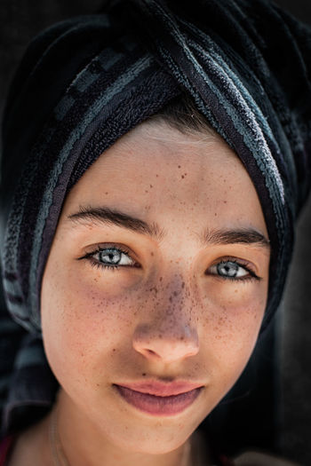 Close-up portrait of girl wearing towel on head