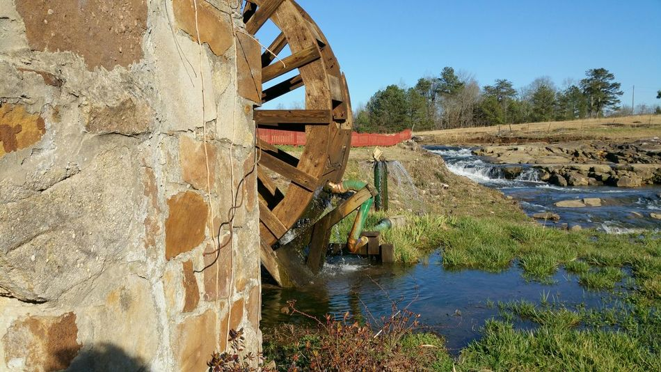 The Purist (no Edit, No Filter) Water Wheel Old Mill  Bucolic Landscape Artistic Composition Unusual Beauty Serene Relaxing Artistic Photography The Passing Of Time The Past Life Gone By This Week On Eyeem Showcase: February Outdoors Tranquil Scene Light And Shadow Days Of Old Old Building Exterior Nostalgia Pattern, Texture, Shape And Form Sky