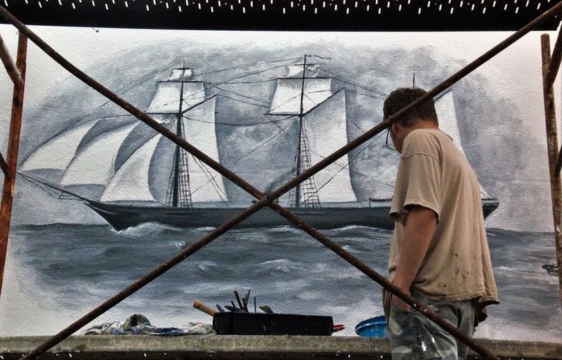 The Alabama Comes Alive Again Auto Post Production Filter Bar Restaurant Casual Clothing Civil War Day Mural Art Nautical Vessel Outerwall Painter Painting Scaffolding Standing The Alabama Transportation Water