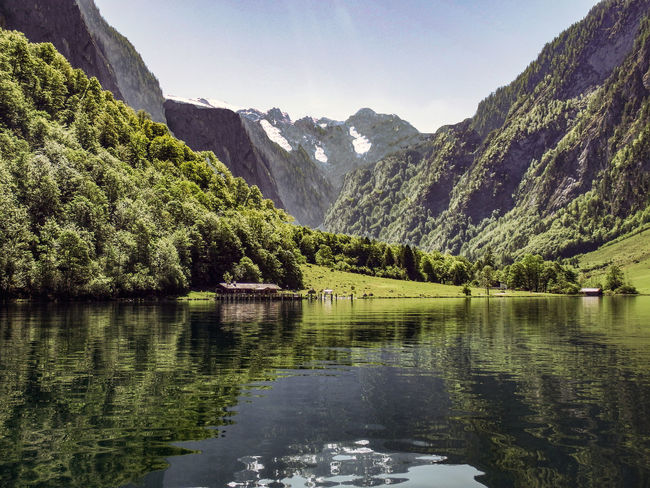 Heaven on Earth Alpine Meadows Beauty In Nature Day Idyllic Lake Lake Königssee Mountain Mountain Range Nature No People Outdoors Peaceful Setting Reflection Reflections In The Water Scenics Serene Beauty Serene Tranquil Outdoors Sky Snow Patches Tranquil Scene Tranquility Tree Water Waterfront Waterscape