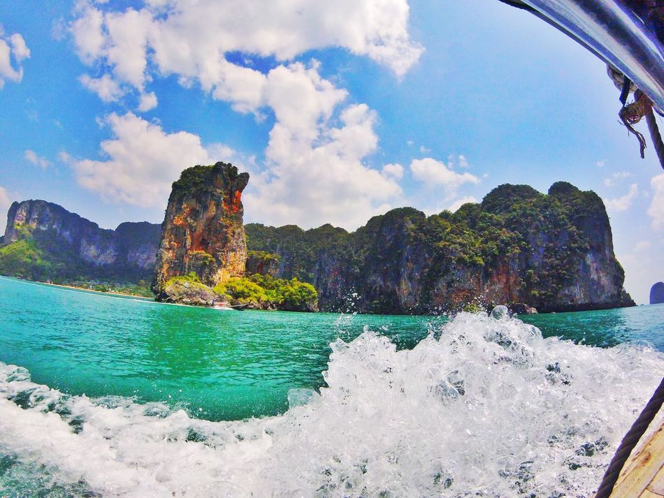 Limestone cliffs and emerald seas on the way to Railley beach, Krabi Water Beauty In Nature Sea Nature Scenics Sky Mountain Rock - Object No People Outdoors Tranquil Scene Travel Destinations Beach Tranquility Day Cloud - Sky