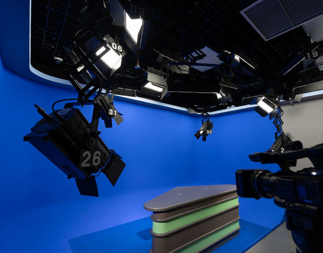 Low angle view of lighting equipment hanging on ceiling