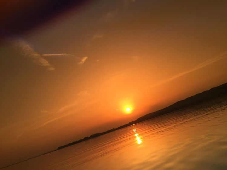 Beach Beauty In Nature Lake Nature Orange Color Scenics Sea Silhouette Sky Sun Sunset Tranquil Scene Tranquility Water