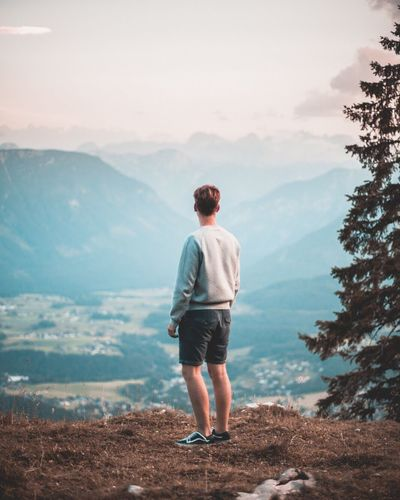 Mountain Real People Rear View Nature One Person Full Length Scenics Lifestyles Leisure Activity Casual Clothing Standing Beauty In Nature Landscape Sky Young Men Mountain Range Day Outdoors Young Adult Tree