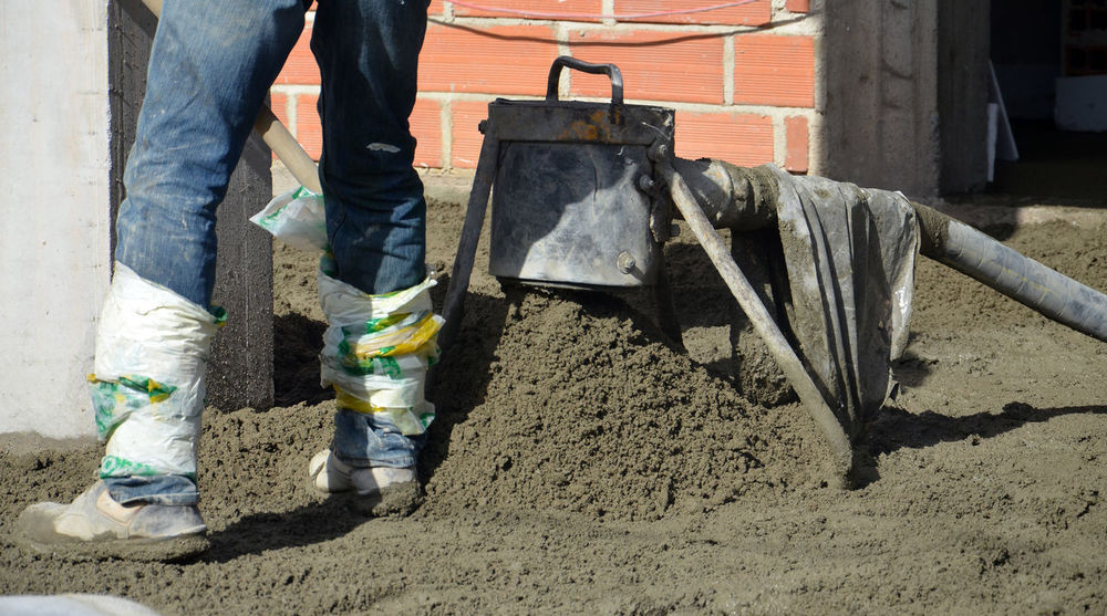 smooth concreting the floor Boots Cement Concrete Concreting Construction Construction Industry Construction Site House Man At Work New House Protective Workwear Smooth Tool Worker Workers Area Workers At Work