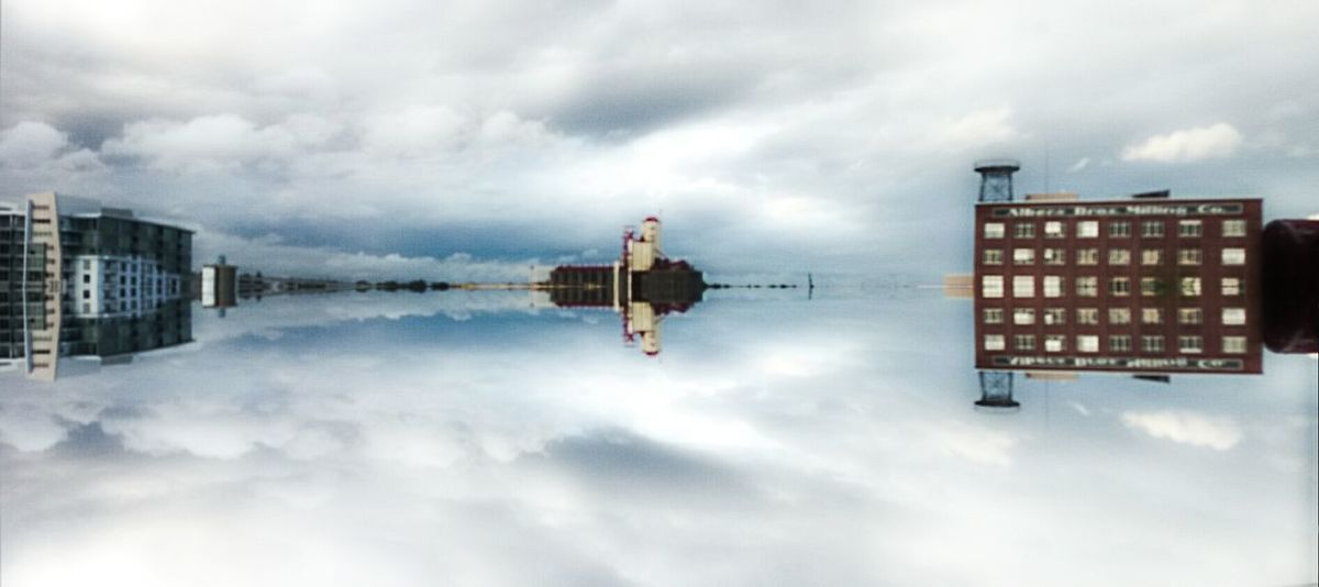 Floating City Mirror Image Clouds Industrial