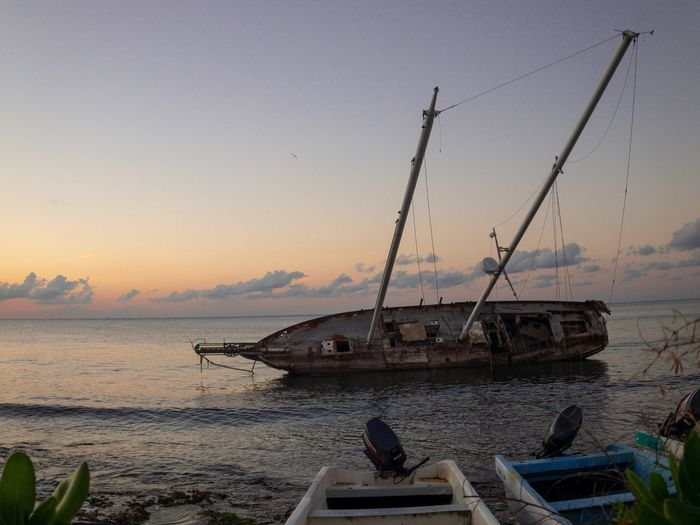 Ship at sunset Water Nautical Vessel Sky Transportation Sunset Sea Mode Of Transportation Nature Beach Scenics - Nature Beauty In Nature Ship Tranquility Orange Color Tranquil Scene No People Shipwreck Land Fishing Industry Outdoors