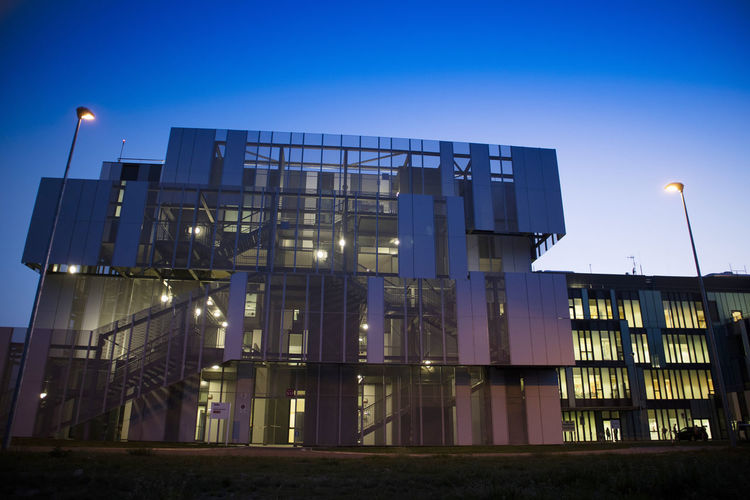 Architecture Built Structure Building Exterior Sky Illuminated Dusk Night No People Low Angle View Lighting Equipment Nature Building Clear Sky Blue City Modern Outdoors Light - Natural Phenomenon Industry Office