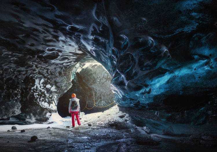 Ice Adventure Beauty In Nature Cave Cavern Exploration Full Length Holiday Leisure Activity Lifestyles Model Nature One Person Outdoors person Real People Rear View Rock Rock - Object Solid Standing Travel Trip Vacations Go Higher Go Higher
