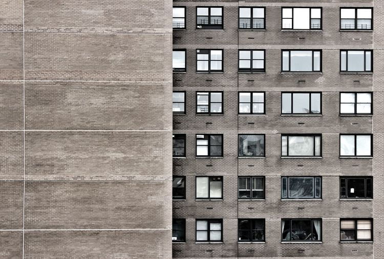 EyeEmNewHere Living New York Apartment Architecture Brick Building Building Exterior Built Structure Concrete Day Dull Front View Full Frame Grey No People Outdoors Somber Stone Window The Graphic City The Architect - 2018 EyeEm Awards
