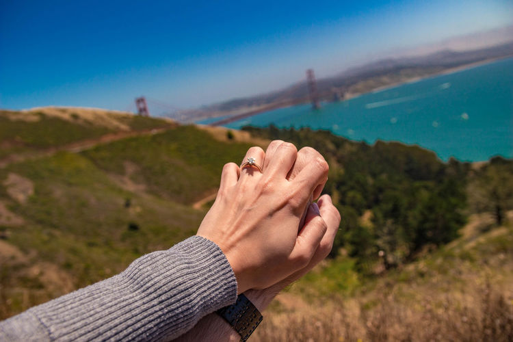 Love at Golden Gate Bridge Engagement Adult Adults Only Beauty In Nature Blue Close-up Day Focus On Foreground Human Body Part Human Hand Leisure Activity Lifestyles Men Mountain Nature Outdoors People Personal Perspective Real People Ring Scenics Sky Water Women
