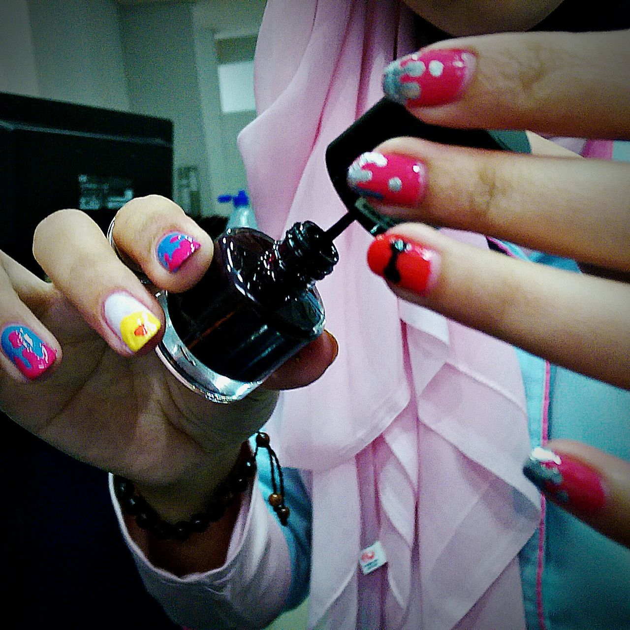 human hand, human body part, human finger, nail polish, real people, nail art, fingernail, women, one person, fashion, ring, holding, lifestyles, manicure, pink color, indoors, beauty, close-up, perfume, painting fingernails, day, adult, people, adults only