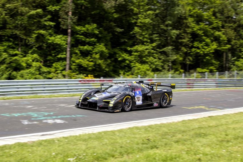 Nürburgring Nordschleife Auto Racing Blurred Motion Car Competition Day Driving Mode Of Transportation Motion Motor Racing Track Motor Vehicle Motorsport Nature Nürburgring Racetrack Outdoors Plant Racecar Road Sign Speed Sport Sports Race Transportation Tree