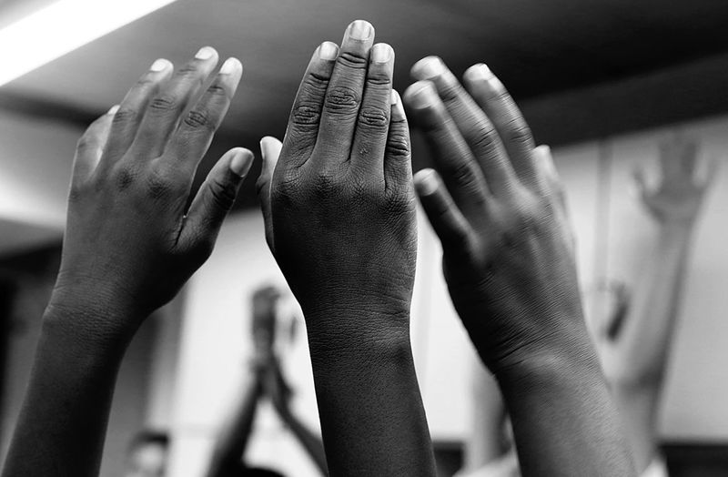 Cropped image of students hands in classroom