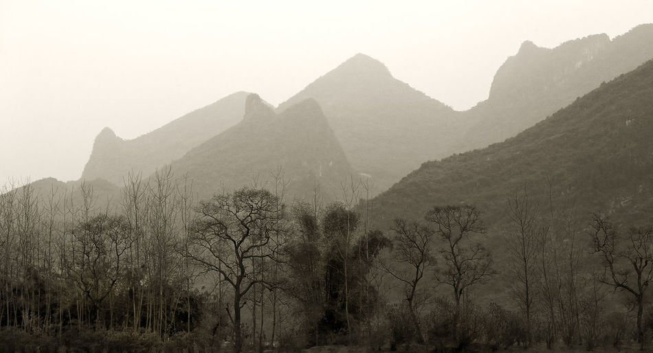 Been There. Gui Lin China Mountains Beauty In Nature Day Fog Landscape Mist Mountain Mountain Range Nature No People Outdoors Scenics Sky Tranquil Scene Tranquility Tree