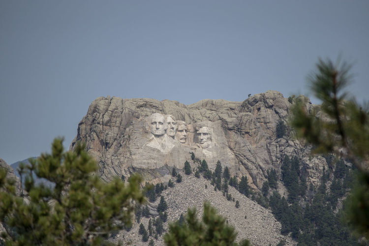 Mount Rushmore Mount Rushmore National Memorial South Dakota Art And Craft Clear Sky Copy Space Craft Day Growth History Human Representation Low Angle View Mountain Nature No People Outdoors Plant Representation Sky Solid Sunlight Text Tree