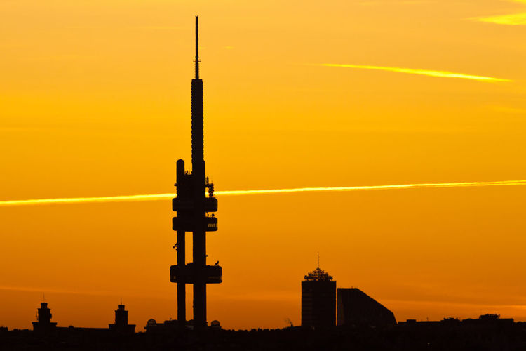 Silhouette of building against sky during sunset
