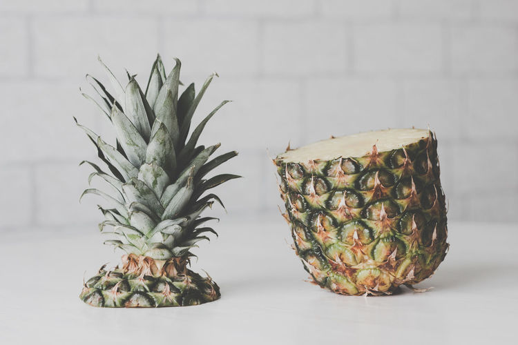 Pineapple Tropical Fruit Fruit Healthy Eating Indoors  Food Food And Drink No People Wellbeing Close-up Still Life Pattern Table Freshness Green Color Plant Studio Shot Focus On Foreground Nature Decoration Houseplant