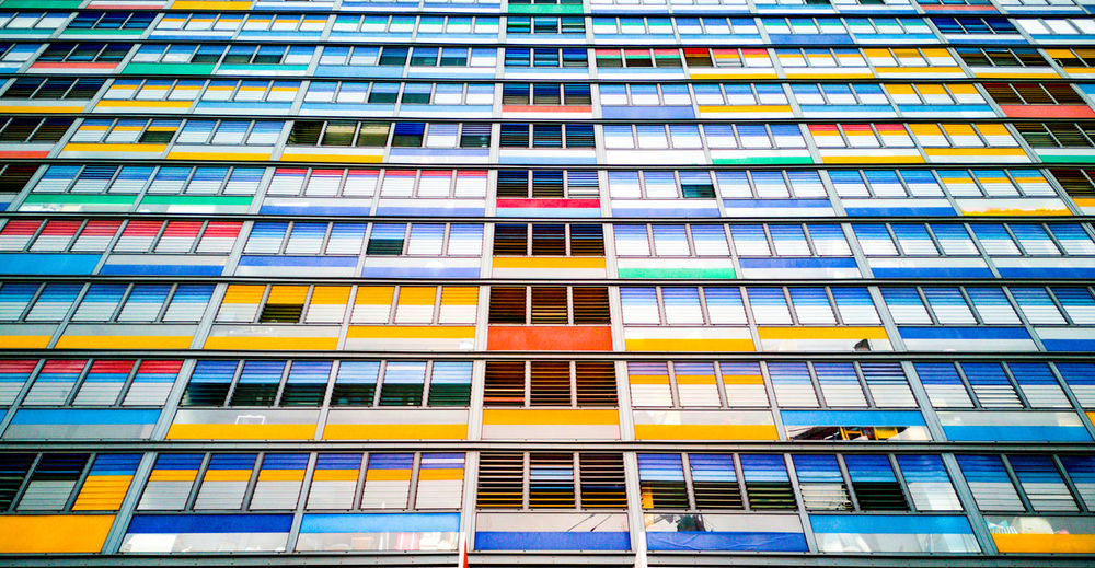 Colorful buildings featuring different colours at each floors. Shot from a low angle as I stood on the ground, lines are running up, merging toward the center. Façade Flat Modern Multicolors  Windows Nord Dwelling Low Angle View Low Angle Urban Urban Geometry City City Life Building Building Exterior Colors Colorful Colours Colourful Perspective Lille, France Multi Colored Backgrounds Architecture Repetition