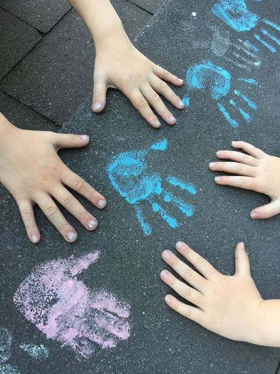 Cropped hands of kids playing on steps