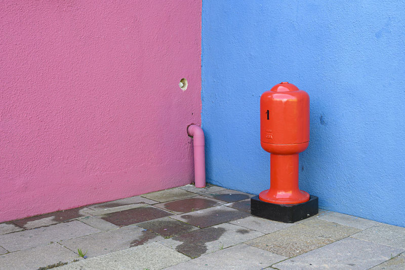 Red fire hydrant on wall