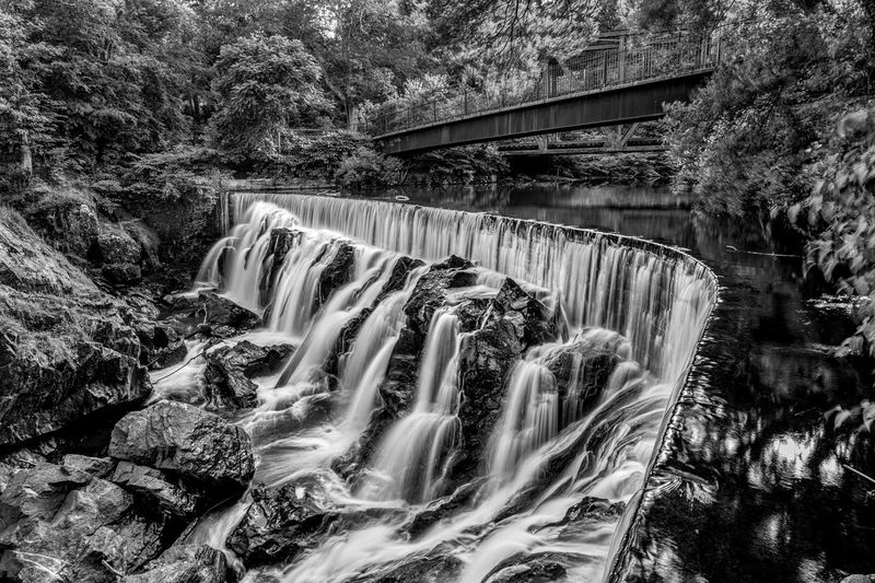 Yantic Falls in Black and White Beauty In Nature Blackandwhite Blurred Motion Bnw_collection Bridge Bridge - Man Made Structure Connection Flowing Flowing Water Long Exposure Motion Nature No People Plant Scenics - Nature Tree Water Waterfall Waterfall_collection Waterfalls