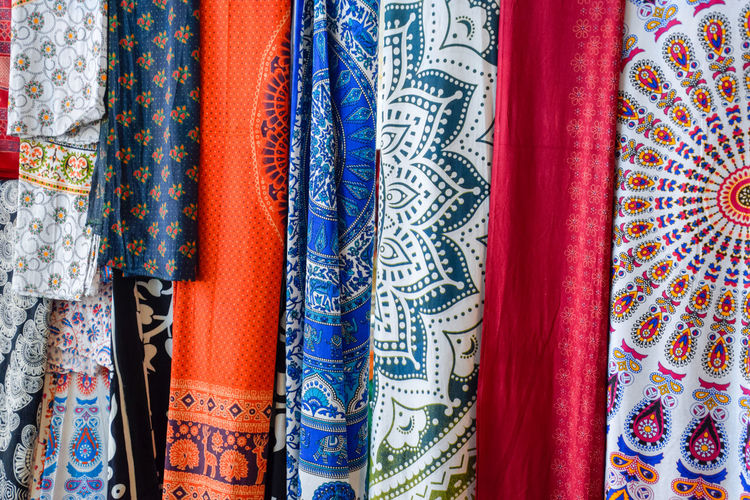 Multi Colored Textile Variation Choice Pattern Full Frame Backgrounds Retail  Market Clothing No People For Sale Side By Side Indoors  Industry Design Retail Display Traditional Clothing In A Row Business Store Fashion Silk Scarf Floral Pattern