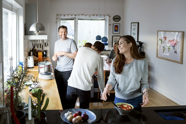 People standing in kitchen at home