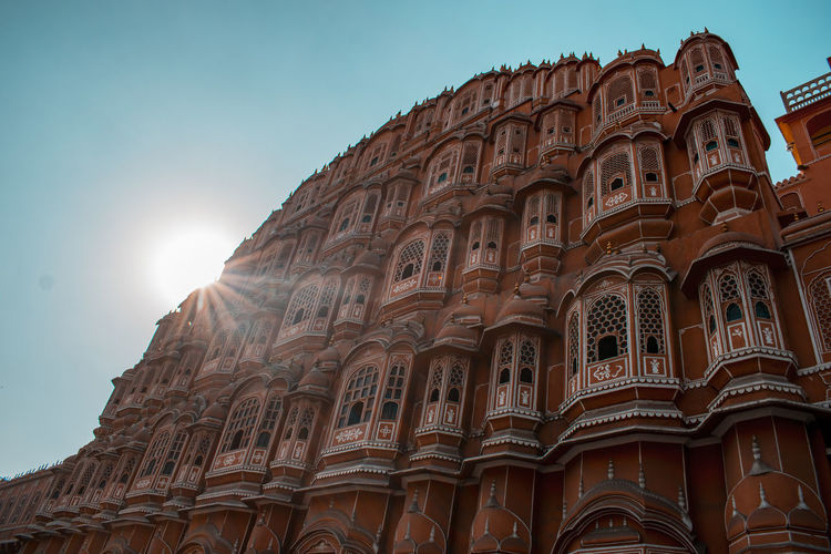 Low angle view of hawa mahal against sun