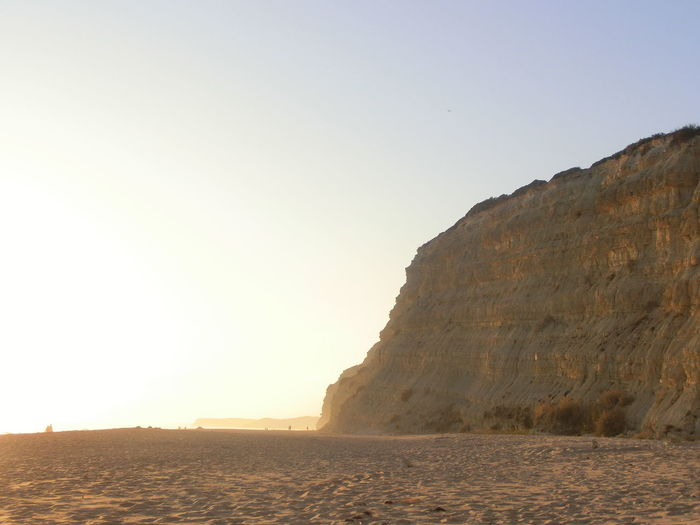 Sunlight Glow Beach Beauty In Nature Clear Sky Day Nature No People Outdoors Sand Scenics Sea Sky Tranquility Water Cliff