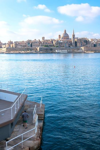Sliema's view of Valletta Cityscape City Water Nautical Vessel Urban Skyline Politics And Government Sea Blue Sky Architecture Tourboat Sailboat Moored Commercial Dock Dock Sailing Ship Container Ship Crane - Construction Machinery Sailing Boat Boat Rudder Passenger Ship Shipyard Yachting Sailing Industrial Ship Cargo Container Regatta Marina Port