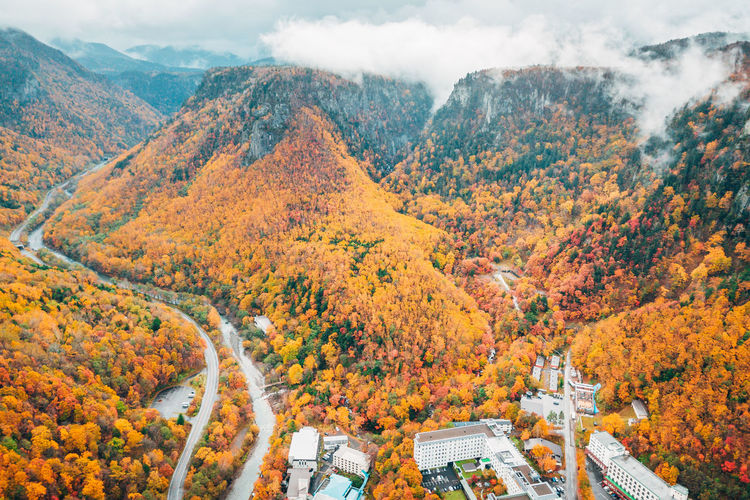 Daisetsuzan Autumn Change Beauty In Nature Scenics - Nature Mountain Tree Nature Plant Orange Color Cloud - Sky Day Architecture High Angle View No People Sky Non-urban Scene Tranquility Idyllic Environment Built Structure Outdoors Autumn Collection Fall