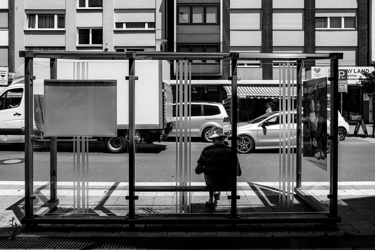 Waiting for the bus ... Urban Perspectives Street Photography Black & White Monochrome Bus Stop Full Length Transportation Architecture Mode Of Transportation Rear View Built Structure One Person Real People Building Exterior Lifestyles Railing City Land Vehicle Men Street Outdoors Leisure Activity Walking Day Waiting The Devil's In The Detail Black And White The Street Photographer - 2019 EyeEm Awards