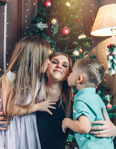 Mother and girl with christmas tree