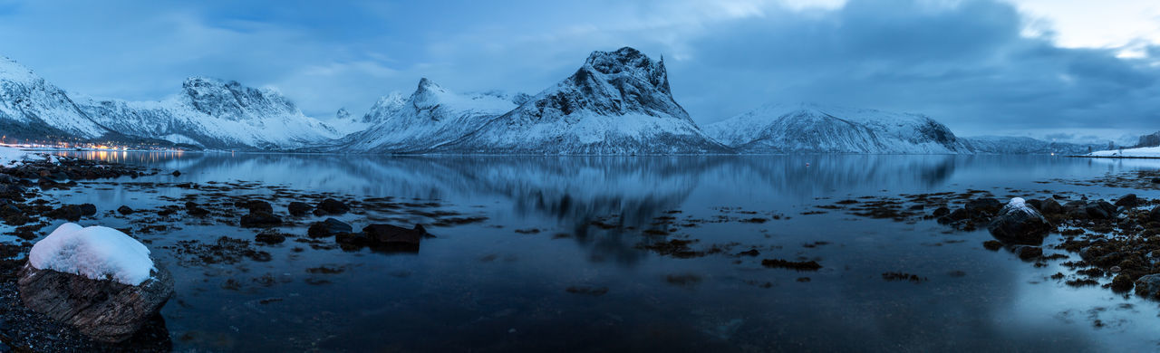 Arctic Bay Beauty In Nature Blue Hour Cold Cold Temperature Evening Horizon Over Water Horizontal Symmetry Landscape Mountain Mountain Range Mountains Nature Panorama Panoramic View Rock Scenics Sea Snow Stone The Great Outdoors - 2016 EyeEm Awards Winter Wintertime Northern Norway