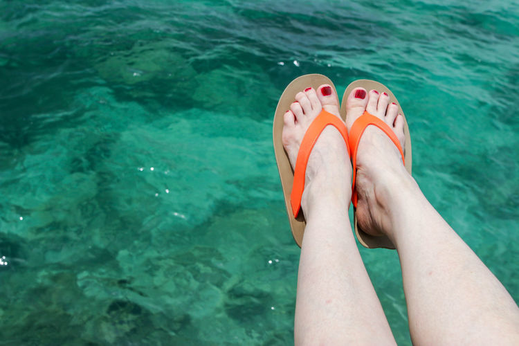 holiday vacation Adult Body Part Day High Angle View Human Body Part Human Foot Human Leg Leisure Activity Lifestyles Low Section Nail Nail Polish One Person Outdoors Personal Perspective Real People Sea Slipper  Swimming Pool Toenail Turquoise Colored Water Women