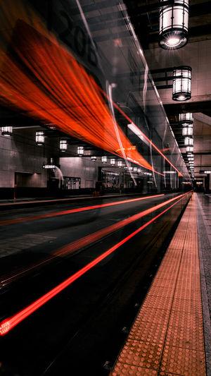 Train at railroad station at night long exposure