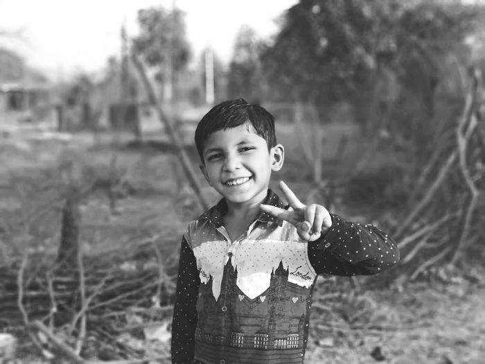 EyeEm Selects Blackandwhite Village Rural Potrait Boy Water Child Portrait Smiling Childhood Happiness Cheerful Boys Standing Looking At Camera